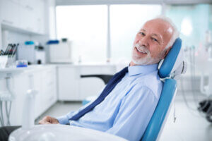 How can dental implants restore facial features